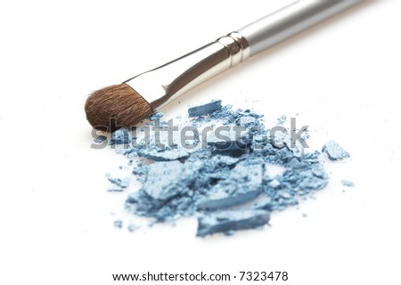 blue glittering eyeshadow and silver brush - stock photo