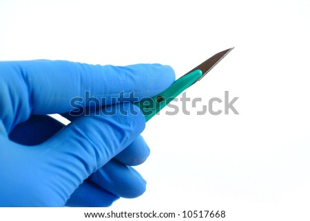 blue gloved hand holding scalpel on white background - stock photo
