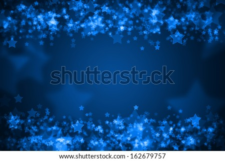 Blue glowing star bokeh holiday background - stock photo