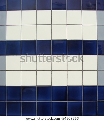 blue gray white tile pattern on a wall - stock photo