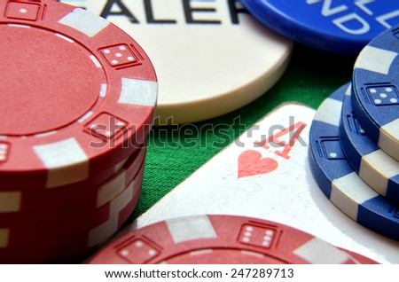 Blue, green and red poker chips pile and ace detail - stock photo