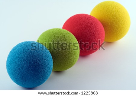 Blue, green, red and yellow sponge balls - stock photo