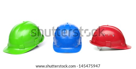 Blue, green, red hard hats - stock photo