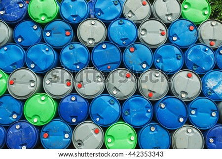 blue, grey and green oil barrels on a pile, Chemical Plant, Plastic Storage Drums, - stock photo