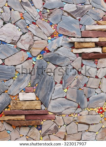 blue grey deep and light brown color stones on stone wall surface background - stock photo