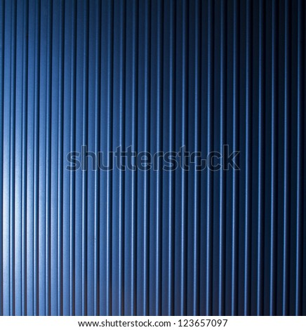 Blue grooved metal texture - stock photo