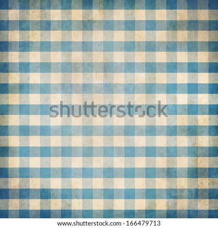 Blue grunge checked gingham picnic tablecloth background - stock photo