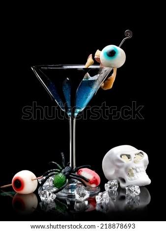 Blue Halloween cocktail - stock photo