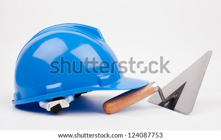 blue hardhat,  and mason trowel isolated on white - stock photo