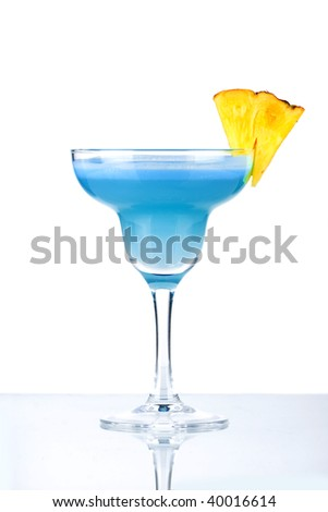 Blue Hawaii alcohol cocktail with pineapple isolated on white background - stock photo