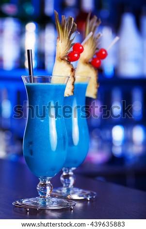 Blue Hawaiian cocktails shot on a bar in blue light - stock photo