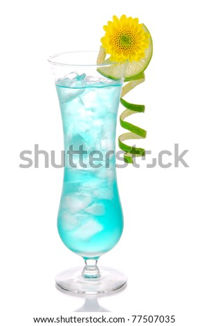 Blue hawaiian curacao cold cocktail decorated with pineapple, lemon twisted spiral and summer beautiful pink flower cocktails glass filled with ice isolated on a white background - stock photo
