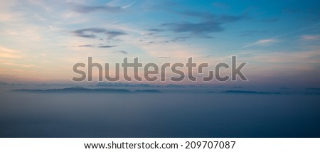 Blue horizon and mystical view on the Dolomites chain of Mountains in the north of Italy - stock photo