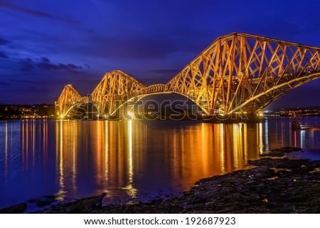 blue hour at Forth Rail Bridge over the Firth of Forth, Edinburgh, Scotland, UK - stock photo