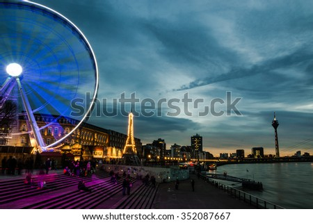 Blue hour scene of the old town of Dusseldorf at the river rhine - stock photo