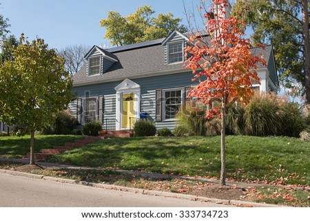 Blue House on Hill with Yellow Door - stock photo