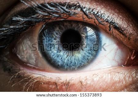 Blue human eye extreme macro shot - stock photo