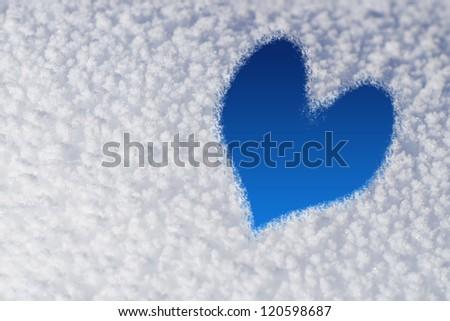 Blue Ice Heart on Snow - stock photo