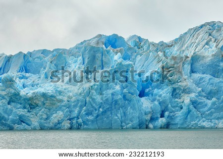 Blue icebergs and snowy mountains at Grey Glacier in Torres del Paine National Park, Patagonia, Chile  - stock photo