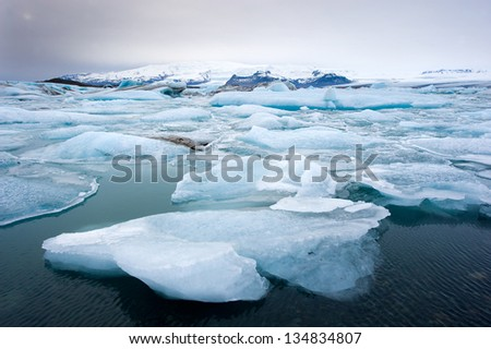 Blue icebergs floating in the jokulsarlon lagoon in Iceland in the winter - stock photo