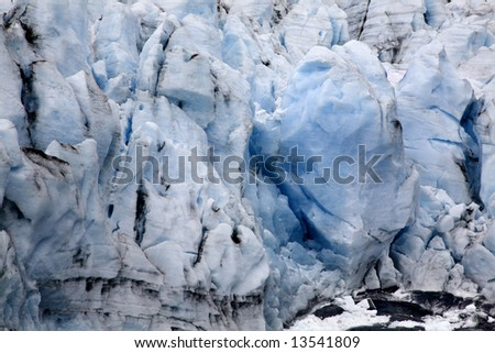 Blue Icy Portage Glacier with Crevasses Anchorage Alaska  The blue ice means it is a glacier. - stock photo
