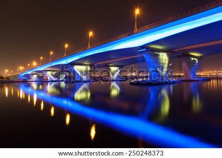 Blue illuminated Al Garhoud Bridge in Dubai, United Arab Emirates - stock photo