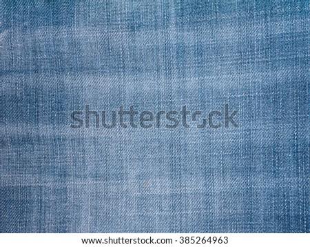 Blue indigo washed faded denim fabric background - stock photo