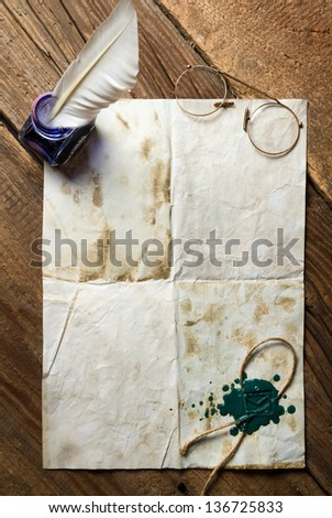 Blue ink, feather on old vintage letter with green sealing wax - stock photo