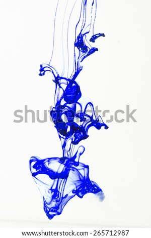 Blue ink liquid in water making abstract forms - stock photo