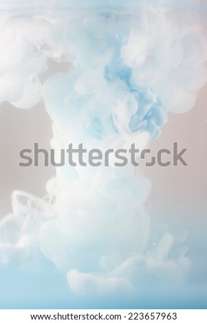 blue Ink swirling in water, cloud of ink in water isolated on white. Abstract banner paints. - stock photo