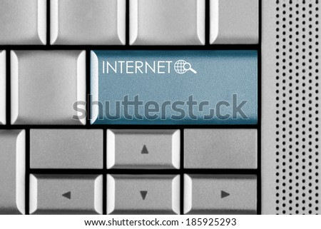 Blue INTERNET key on a computer keyboard with clipping path around the INTERNET key - stock photo