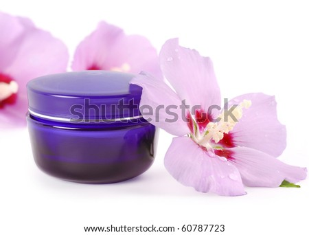 blue jar of cream with delicate flowers - stock photo