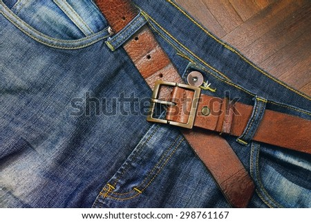 Blue jeans and leather belt. Men accessories. - stock photo
