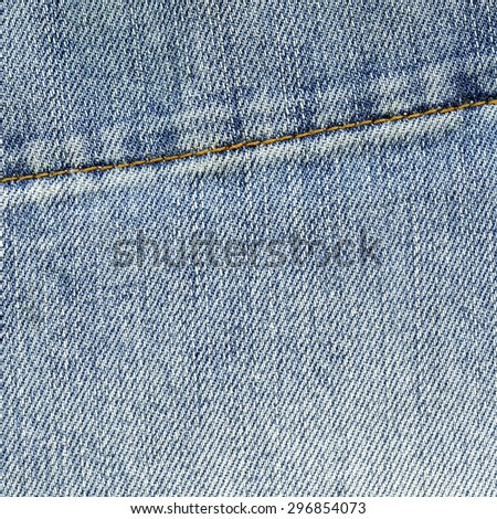blue jeans background decorated with seam - stock photo