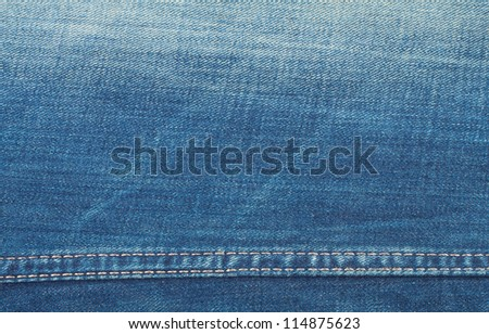 Blue jeans background with seam and scrapes - stock photo