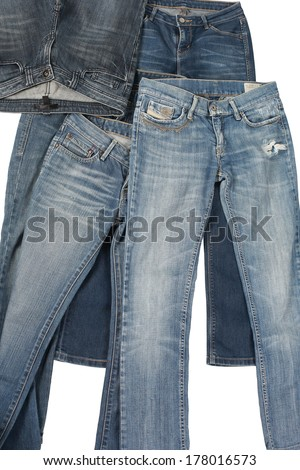 Blue jeans on wooden hanger, isolated on white. - stock photo