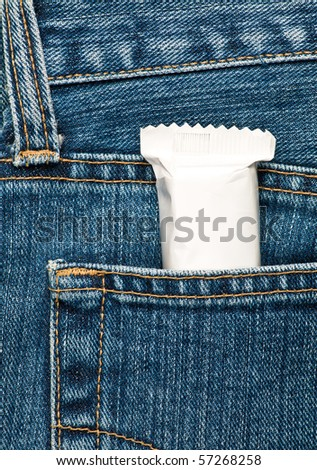 Blue jeans pocket with chocolate or cereal bar - stock photo