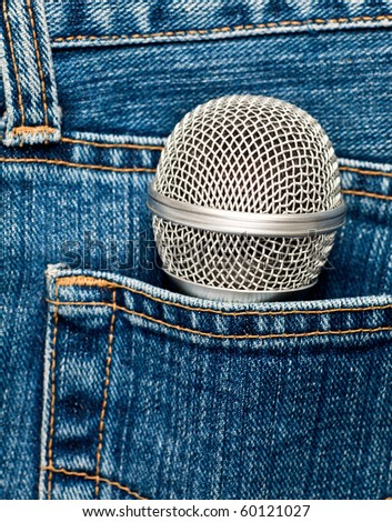 Blue jeans pocket with microphone - stock photo