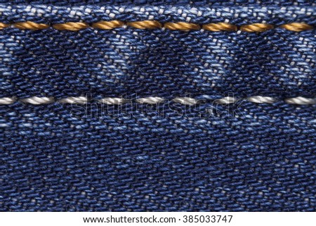 Blue jeans Texture with the stitched seam, jeans textile close up - stock photo