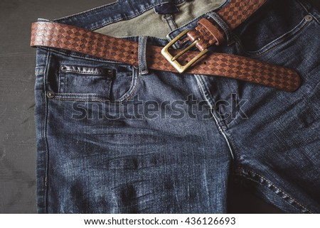 Blue jeans with leather belt vintage color - stock photo