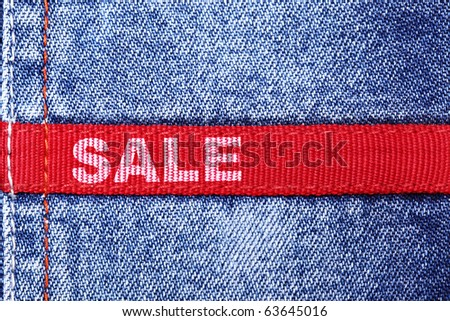 Blue jeans with red label and word SALE - stock photo