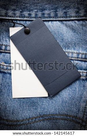 Blue jeans with tags. - stock photo