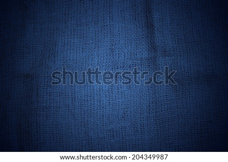 Blue jute sackcloth texture closeup for background with subtle light - stock photo