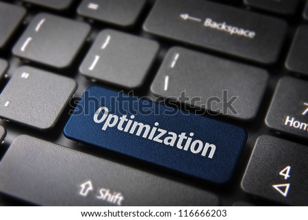 Blue key with Optimization word on laptop keyboard. Included clipping path, so you can easily edit it. - stock photo