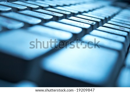 blue keyboard of the personal computer - stock photo