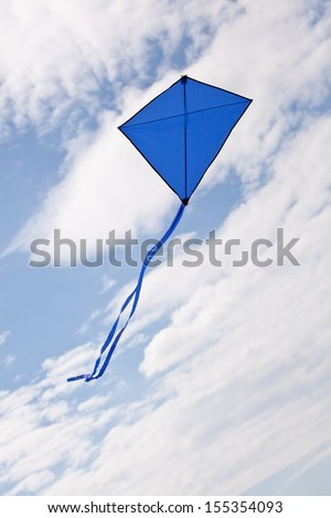 blue kite flying in a beautiful sky clouds - stock photo
