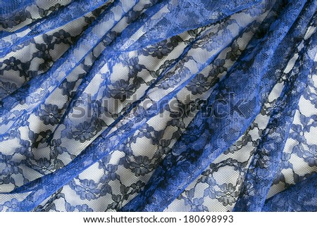 Blue lace draped as a background - stock photo