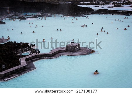 BLUE LAGOON, ICELAND - Aug 26 2014: People bathing in The Blue Lagoon, a geothermal bath resort in the south of Iceland, near Reykjavik. August 26, 2014 in Iceland. - stock photo