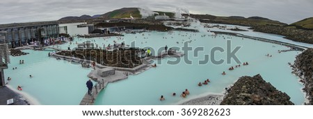 BLUE LAGOON, ICELAND - 23 august 2014: People bathing in The Blue Lagoon, a geothermal bath resort in the south of Iceland, a 'must see' by tourists. Panorama - stock photo