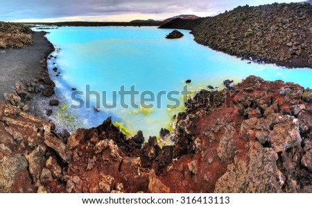 Blue lagoon waters in the lava field landscape of Iceland in winter, HDR - stock photo